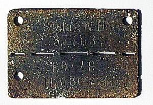 Údaje z nalezené identifikační známky: STALAG IV H 37763